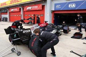 Mechanics work on the car of Lewis Hamilton, Mercedes W12