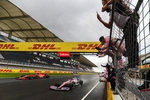 Sergio Perez, Racing Point RP20, 2nd position, and Sebastian Vettel, Ferrari SF1000, 3rd position, cross the finish line