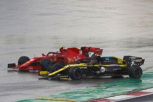 Charles Leclerc, Ferrari SF1000, and Esteban Ocon, Renault F1 Team R.S.20, leave the track