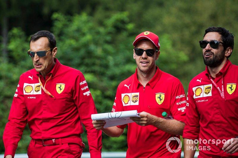 Sebastian Vettel, Ferrari, walks the track with colleagues