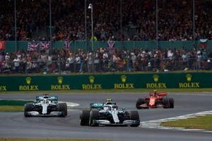 Valtteri Bottas, Mercedes AMG W10, leads Lewis Hamilton, Mercedes AMG F1 W10, and Charles Leclerc, Ferrari SF90