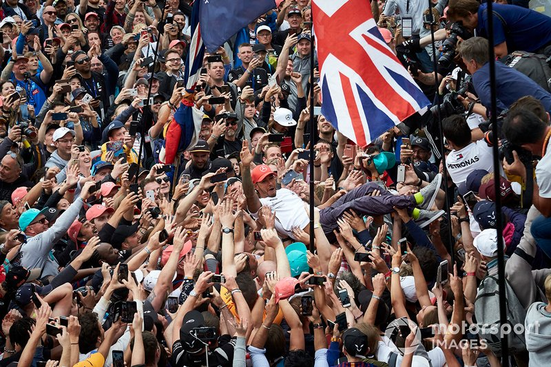 Lewis Hamilton, Mercedes AMG F1, 1st position, celebrates by crowd surfing over his fans