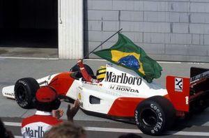 Ayrton Senna, McLaren MP4-7A Honda, with the Brazilian flag.