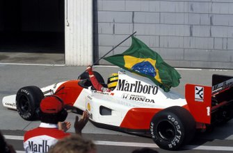 Ayrton Senna, McLaren MP4-7A Honda, with the Brazilian flag.