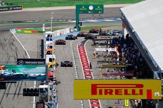 Carlos Sainz Jr., McLaren MCL34, Max Verstappen, Red Bull Racing RB15, Lando Norris, McLaren MCL34, Alexander Albon, Toro Rosso STR14, Nico Hulkenberg, Renault F1 Team R.S. 19, and Pierre Gasly, Red Bull Racing RB15, queue to leave the pits