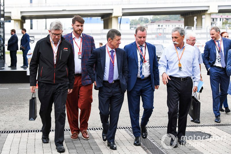 Ross Brawn, Managing Director of Motorsports, FOM, Alexy Titov, Executive Director, Rosgonki, Dmitry Kozak, Deputy Prime Minister of Russian Federation, and Chase Carey, Chairman, Formula 1