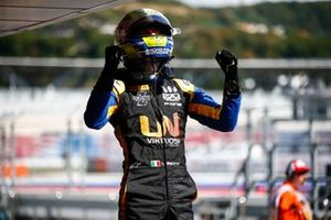 Luca Ghiotto, UNI Virtuosi Racing, celebrates in parc ferme