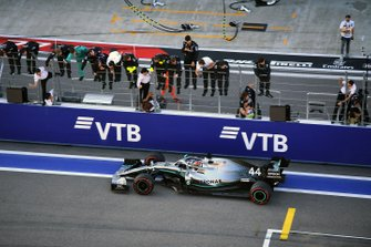 Lewis Hamilton, Mercedes AMG F1 W10, 1st position, passes his team as they celebrate on the pit wall