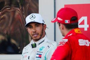 Race winner Lewis Hamilton, Mercedes AMG F1, and Charles Leclerc, Ferrari