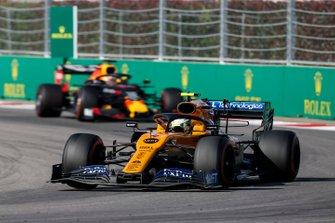 Lando Norris, McLaren MCL34, leads Max Verstappen, Red Bull Racing RB15
