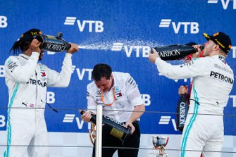 Lewis Hamilton, Mercedes AMG F1, 1st position, sprays Champagne at Valtteri Bottas, Mercedes AMG F1, 2nd position, on the podium