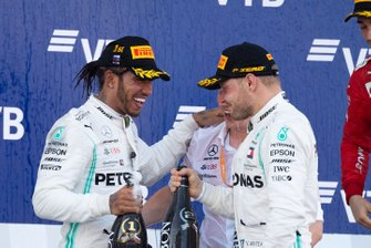 Lewis Hamilton, Mercedes AMG F1, 1st position, and Valtteri Bottas, Mercedes AMG F1, 2nd position, on the podium with Champagne