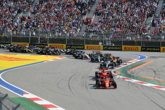 Sebastian Vettel, Ferrari SF90, leads Charles Leclerc, Ferrari SF90, Lewis Hamilton, Mercedes AMG F1 W10, Carlos Sainz Jr., McLaren MCL34, Valtteri Bottas, Mercedes AMG W10, and the rest of the field at the start