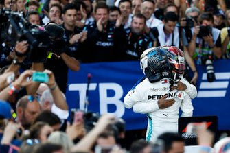 Lewis Hamilton, Mercedes AMG F1, 1st position, celebrates in Parc Ferme with his team mate Valtteri Bottas, Mercedes AMG F1, 2nd position
