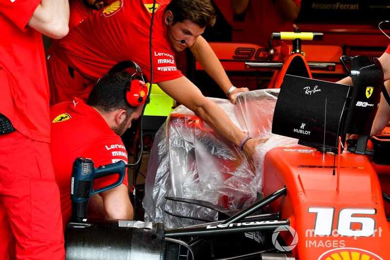 Ferrari mechanics work on their car