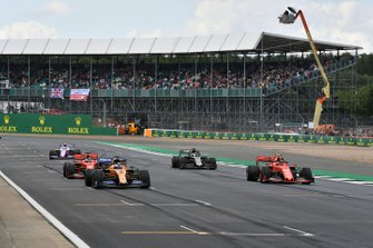 Carlos Sainz Jr., McLaren MCL34, Charles Leclerc, Ferrari SF90, Sebastian Vettel, Ferrari SF90, Romain Grosjean, Haas F1 Team VF-19, and Lance Stroll, Racing Point RP19, practice starts at the end of the session