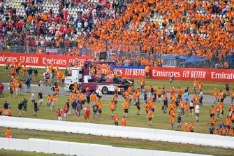 Fans invade the circuit after the race as marshals remove the car of Pierre Gasly, Red Bull Racing RB15