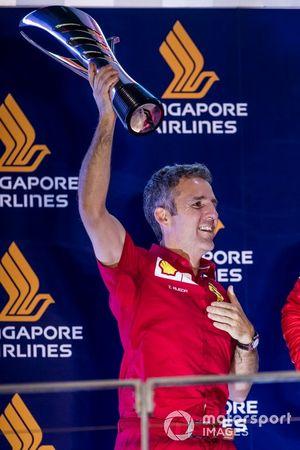 I–aki Rueda, Head of Strategy, Ferrari, lifts the Constructors trophy