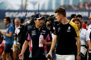 Sergio Perez, Racing Point, talks with Nico Hulkenberg, Renault F1 Team