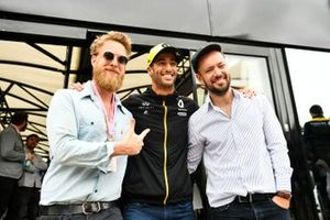 Ted Dwane and Marcus Mumford of the band Mumford and Sons meet Daniel Ricciardo, Renault F1 Team