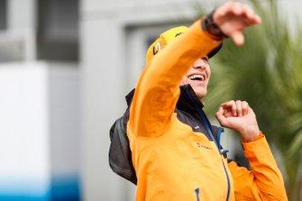 Lando Norris, McLaren, throws a rugby ball