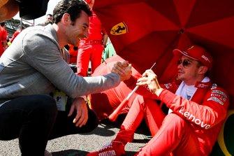 Indy 500 winner Simon Pagenaud talks to Charles Leclerc, Ferrari