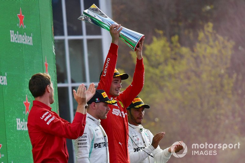 Charles Leclerc, Ferrari, 1st position, lifts his trophy