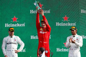 Valtteri Bottas, Mercedes AMG F1, Race winner Charles Leclerc, Ferrari and Lewis Hamilton, Mercedes AMG F1 celebrate on the podium with the trophy