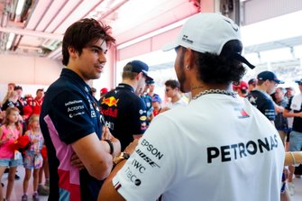 Lance Stroll, Racing Point, talks with Lewis Hamilton, Mercedes AMG F1