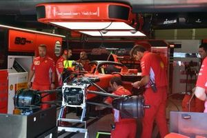 The Ferrari mechanics build the car for Sebastian Vettel, Ferrari SF90, in the garage