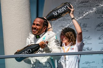 Lewis Hamilton, Mercedes AMG F1, 1st position, celebrates on the podium with his team mate
