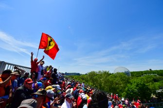 Fans fill up the grandstands on race day