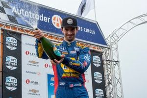 Second place finisher Alexander Rossi, Andretti Autosport Honda sprays champagne on celebrating fans
