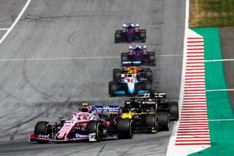 Lance Stroll, Racing Point RP19, leads Daniel Ricciardo, Renault F1 Team R.S.19, Romain Grosjean, Haas F1 Team VF-19, and Robert Kubica, Williams FW42