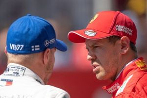 Pole man Valtteri Bottas, Mercedes AMG F1, with Sebastian Vettel, Ferrari, after Qualifying