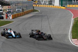 Kevin Magnussen, Haas VF-19, leads Robert Kubica, Williams FW42