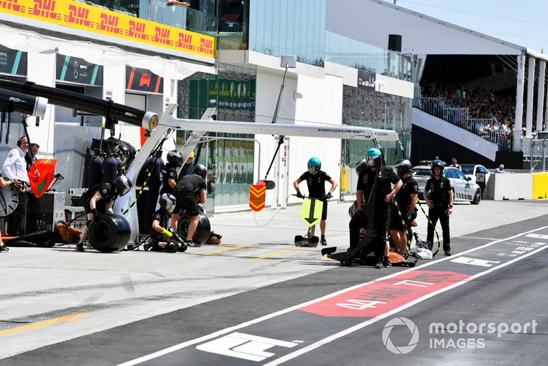 The Mercedes pit crew prepare for a stop