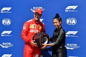 Sebastian Vettel, Ferrari, receives his Pirelli Pole Position Award from actress Liza Koshy