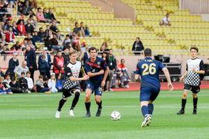 Mick Schumacher and Mark Webber play football