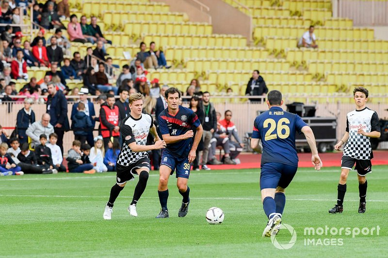 Mick Schumacher and Mark Webber play football