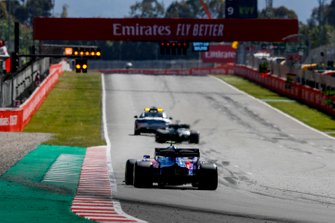 The Safety Car leads Lewis Hamilton, Mercedes AMG F1 W10, and Alexander Albon, Toro Rosso STR14