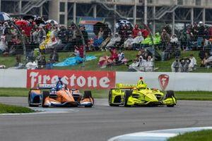 Simon Pagenaud, Team Penske Chevrolet passes Scott Dixon, Chip Ganassi Racing Honda