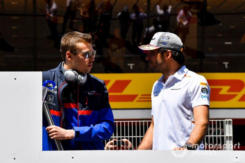 Daniil Kvyat, Toro Rosso, talks with Carlos Sainz Jr., McLaren, at the drivers parade