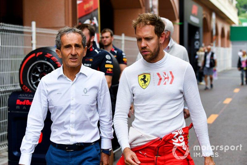Советник Renault Sport F1 Team Ален Прост и гонщик Ferrari Себастьян Феттель