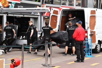 Mercedes AMG F1 team members unload new parts