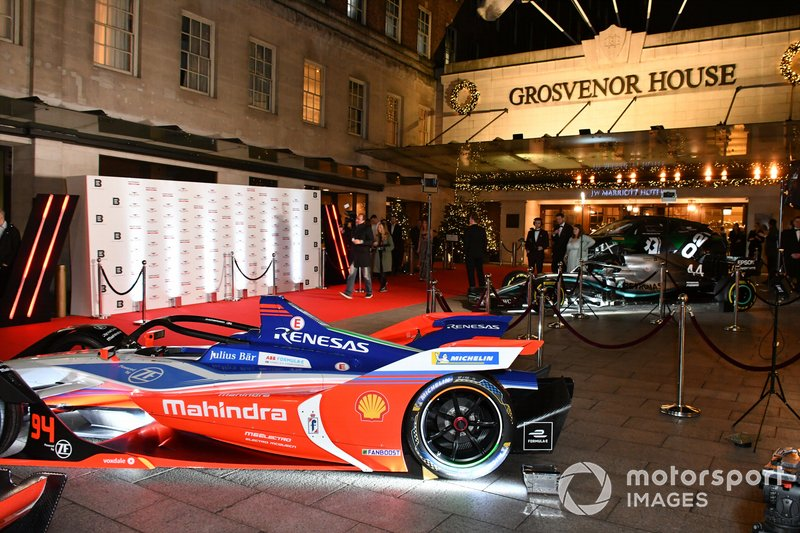Racing cars on display outside the venue