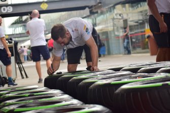 McLaren mechanics with Pirelli tyres