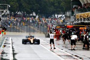Carlos Sainz Jr., McLaren MCL34, in the pit lane
