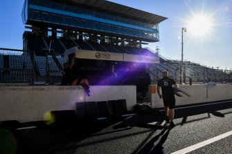 Haas F1 mechanics reinstalling pit wall after Typhoon Hagibis