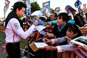 Toto Wolff, Executive Director (Business), Mercedes AMG signs an autograph for a fan